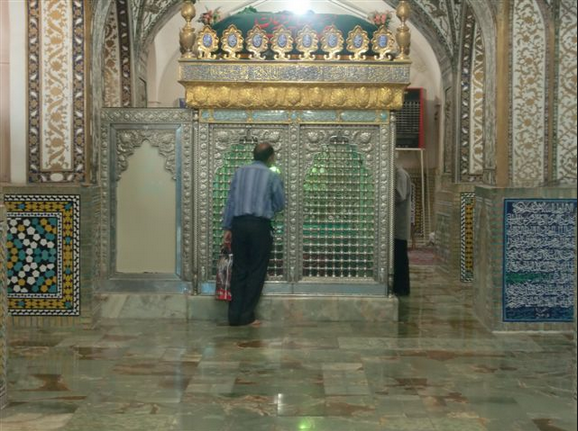 """Shrine of Muhammad Baqir Majlisi and his father (Taqi). A waste of gold and silver. That's not a give star hotel, that's a """"grave' to the Shias!"""