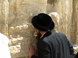 A_man_prays_at_the_Western_Wall_in_Jerusalem