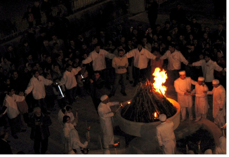 Zoroastrians priests (in white) and public fire-worship