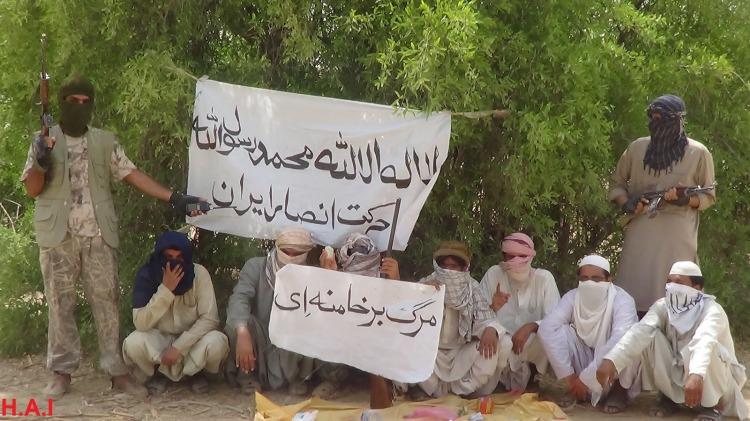 "Shahadah banner and a banner (on bottom) that reads: ""death to Khamenei""."